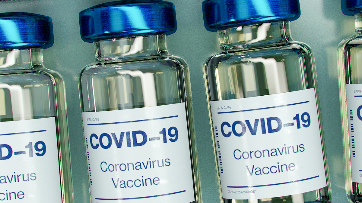 Picture of blue and white plastic bottles featuring COVID-19 Coronavirus Vaccine labels (Photo by Daniel Schludi on Unsplash)